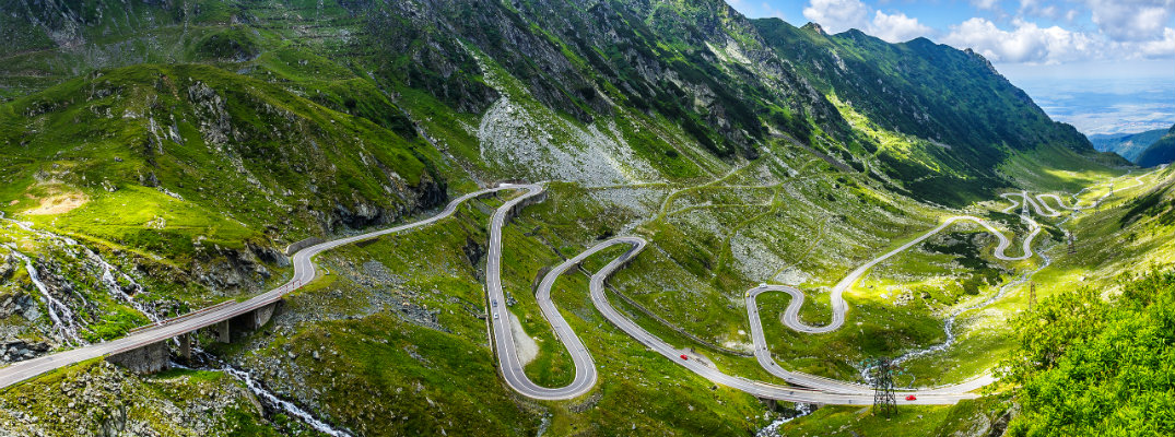A winding mountain road with many hairpin turns