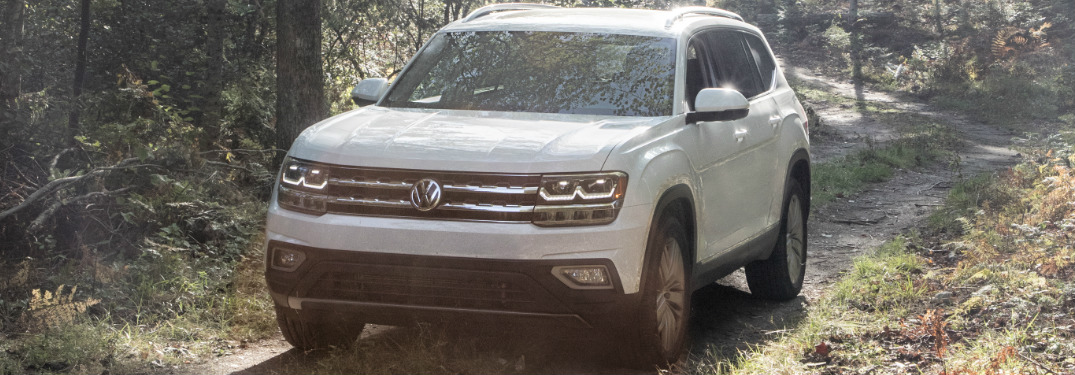 White 2018 VW Atlas Driving Through a Forest