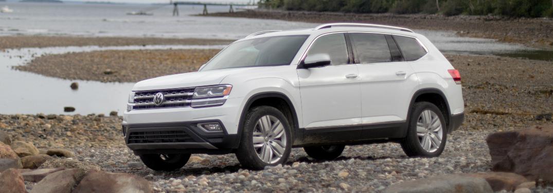 White 2018 VW Atlas Parked by a Lake