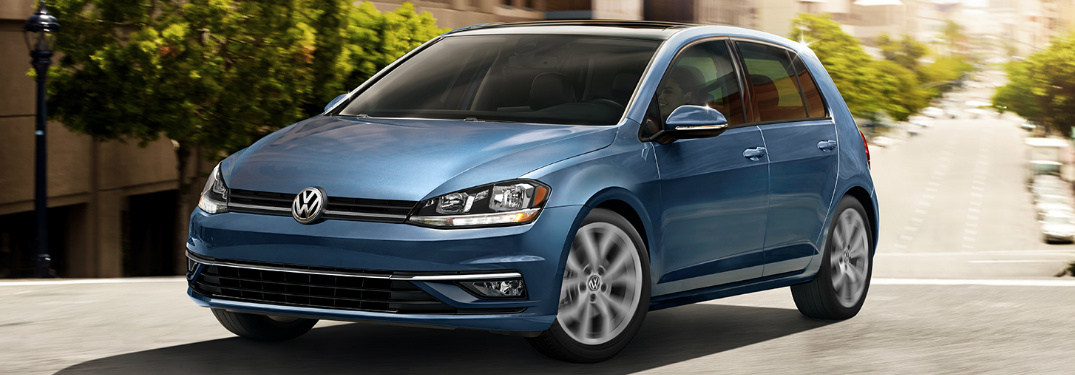 Blue 2019 Volkswagen Golf driving on a city street