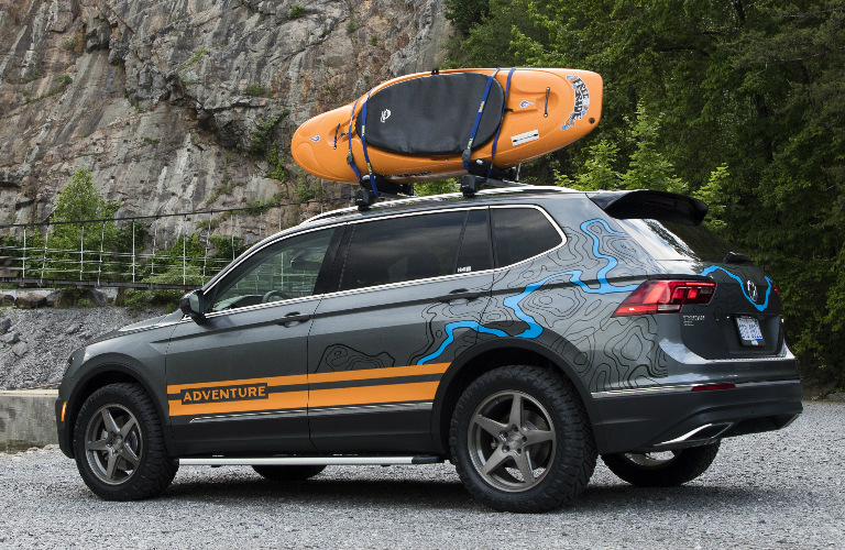 Grey and orange 2019 Volkswagen Tiguan Adventure Concept with a kayak on the roof