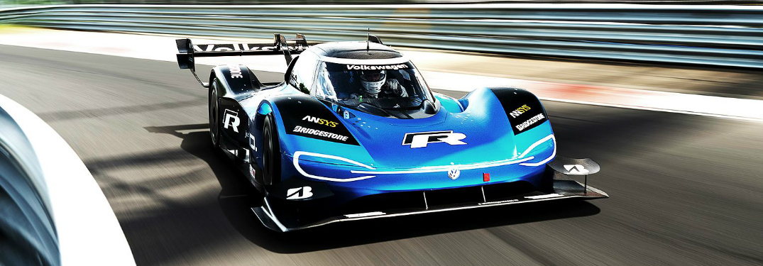 Blue Volkswagen ID R driving on a race track