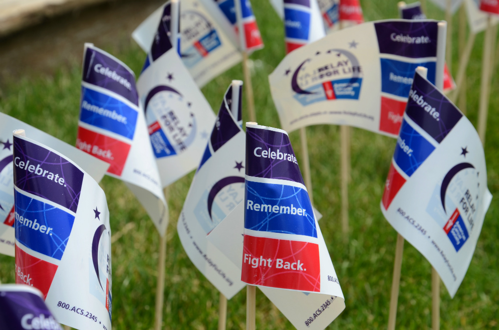 Flags planted in the ground at a Relay for Life event