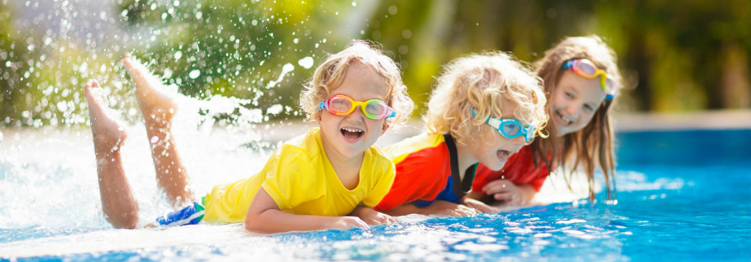 three kids playing in water