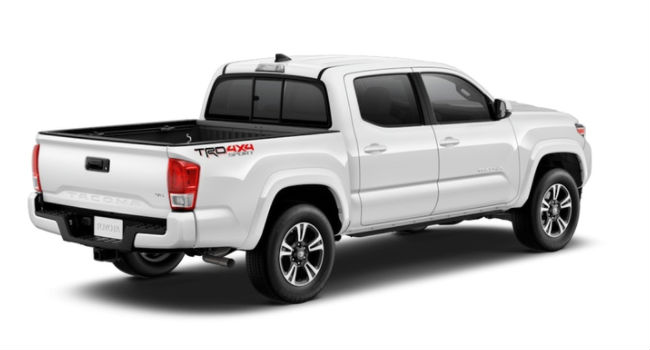 A right rear quarter view of a Super White 2018 Toyota Tacoma for sale at Heritage Toyota