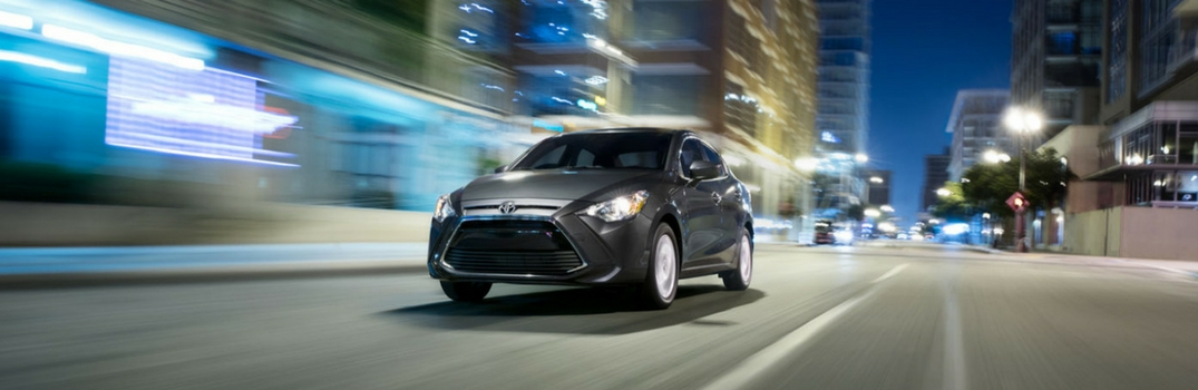 2018 Toyota Yaris iA driving down the road.