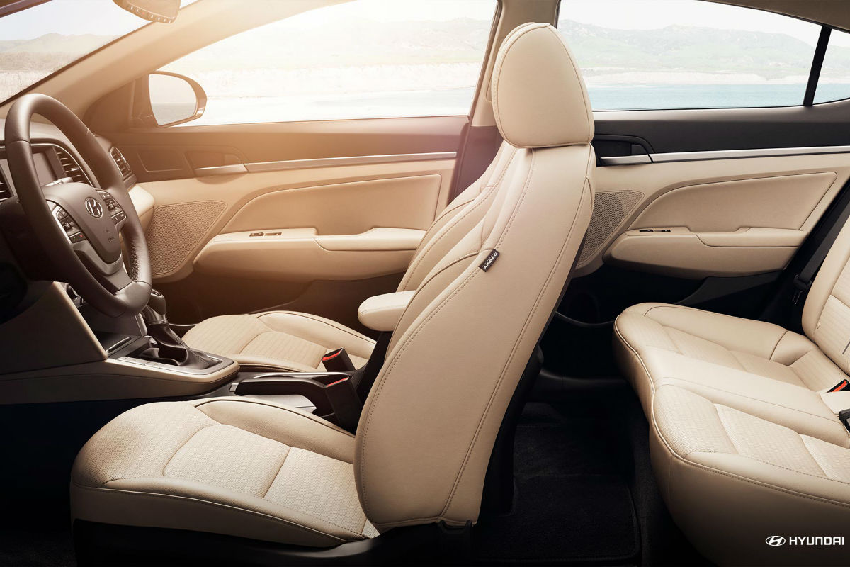 Side view of the two rows of available leather seats inside the 2018 Hyundai Elantra