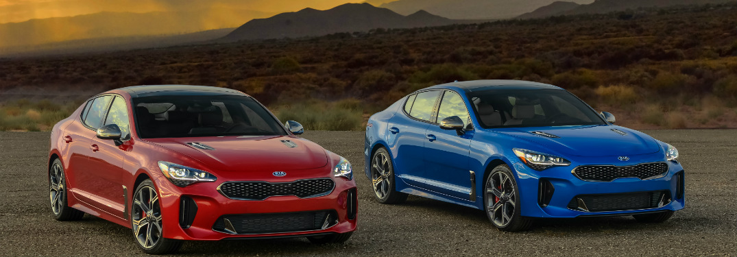 2018 Kia Stinger in red and blue side by side