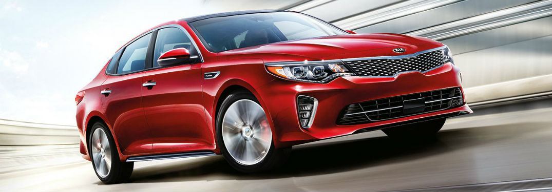 Passenger side exterior view of a red 2018 Kia Optima