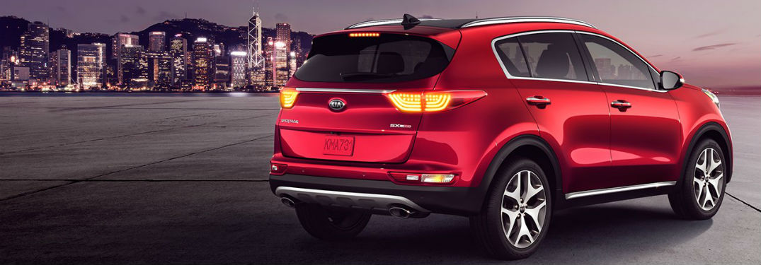 Rear passenger side quarter panel exterior view of a red 2018 Kia Sportage