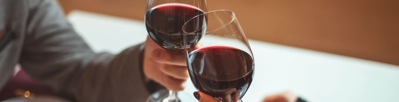 A couple toasting wine glasses