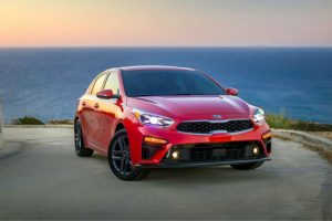 Front exterior view of a red 2018 Kia Forte