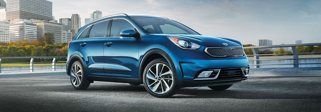 Passenger side exterior view of a blue 2018 Kia Niro