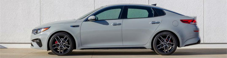 Driver side exterior view of a white 2018 Kia Optima