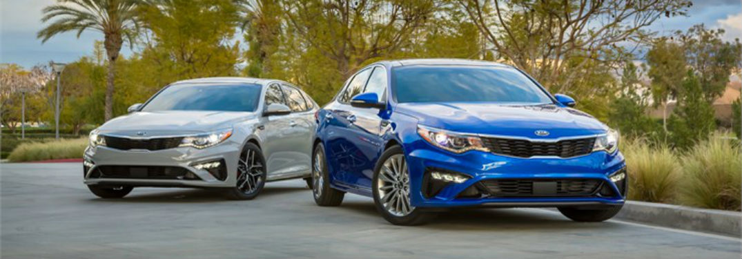 Front exterior view of a white and blue 2018 Kia Optima