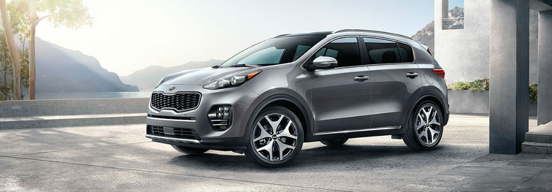 Driver side exterior view of a gray 2018 Kia Sportage