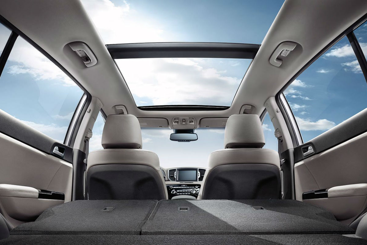 View of the rear seats folded flat inside the 2018 Kia Sportage