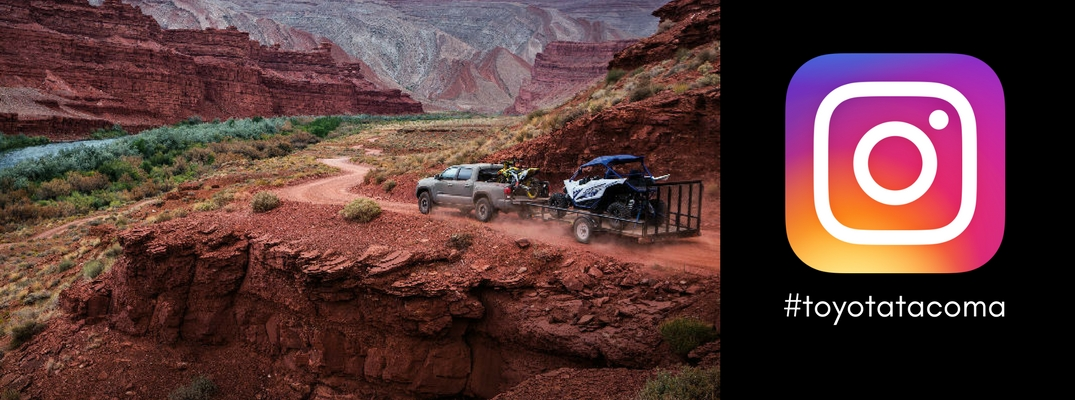 picture-of-2018-Toyota-Tacoma-towing-trailer-down-off-road-decline-next-to-Instagram-logo-and-toyotatacoma-hashtag