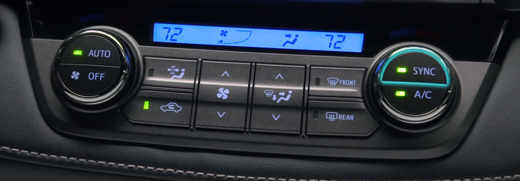 What do the dual-zone automatic climate control buttons mean