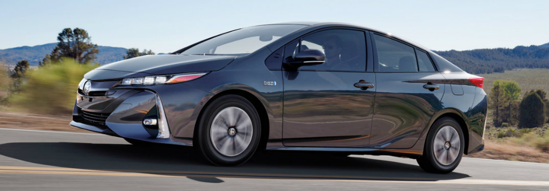 side-profile-of-gray-2018-Toyota-Prius-Prime-driving-on-country-road