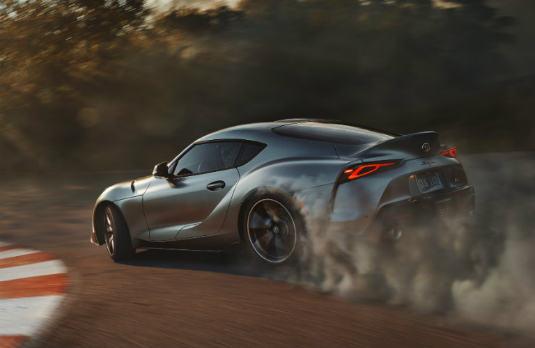 2020-Toyota-Supra-in-Turbulence-Gray-driving-on-racetrack