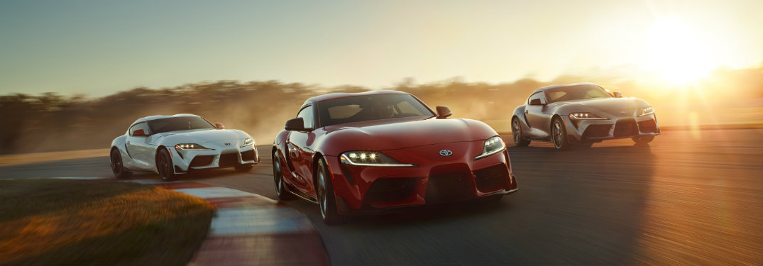 white-red-and-gray-2020-Toyota-Supra-models-on-racetrack