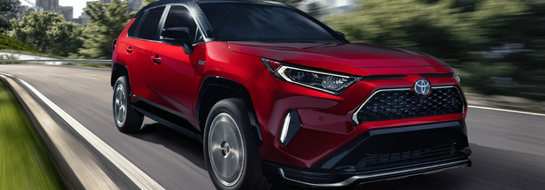 Passenger's side front angle view of red 2021 Toyota RAV4 Prime