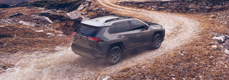 Dark grey 2020 Toyota RAV4 driving on a mountainous road