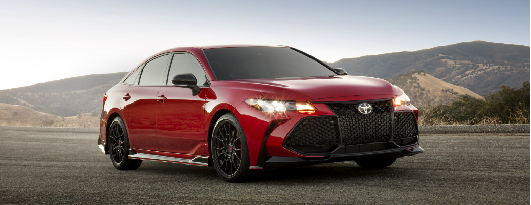 Red 2020 Toyota Avalon with mountains in the background