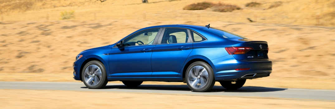 2019 Volkswagen Jetta in blue driving in desert