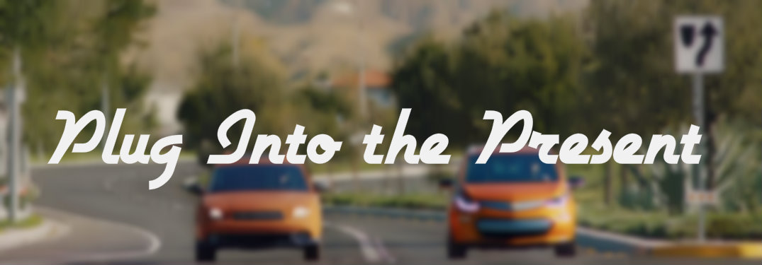 Plug Into the Present text over blurred picture of orange cars