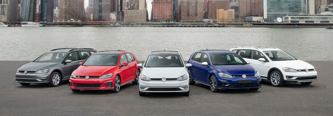 2018 volkswagne golf lineup shown on shore in front of new york city skyline