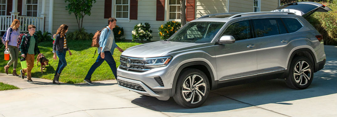 2021 Volkswagen Atlas with family nearby