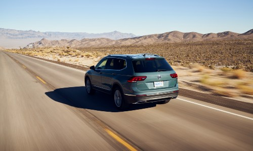 2021 Volkswagen Tiguan exterior driving away on desert road