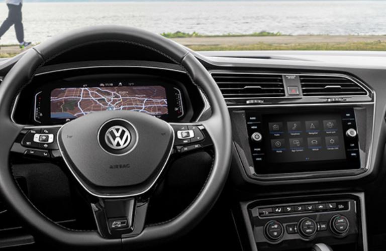Steering wheel of Volkswagen Tiguan standing near the beach