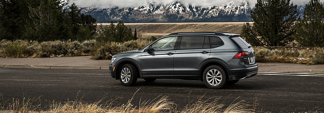 2018 Volkswagen Tiguan gray side view in front of mountains