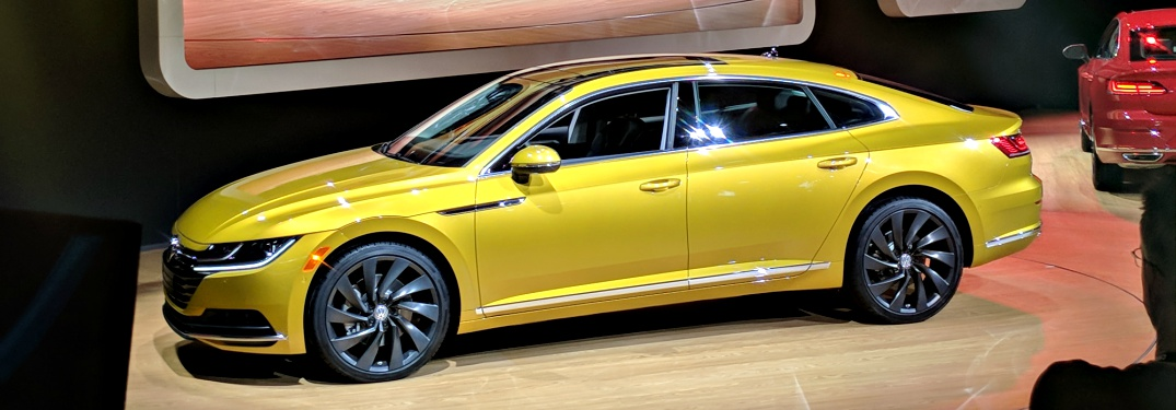 2019 VW Arteon yellow side view at the Chicago Auto Show