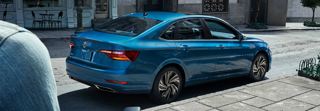 side-profile-of-blue-2019-Volkswagen-Jetta-parked-on-side-of-street
