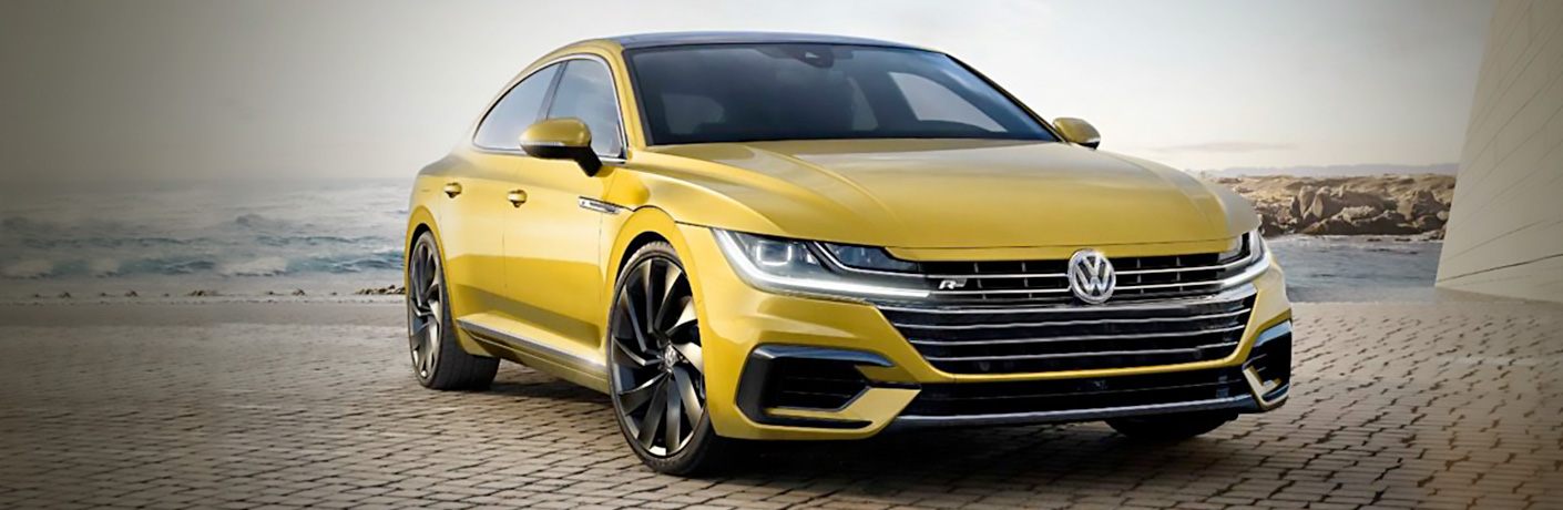 Gold 2019 Volkswagen Arteon parked on the sand