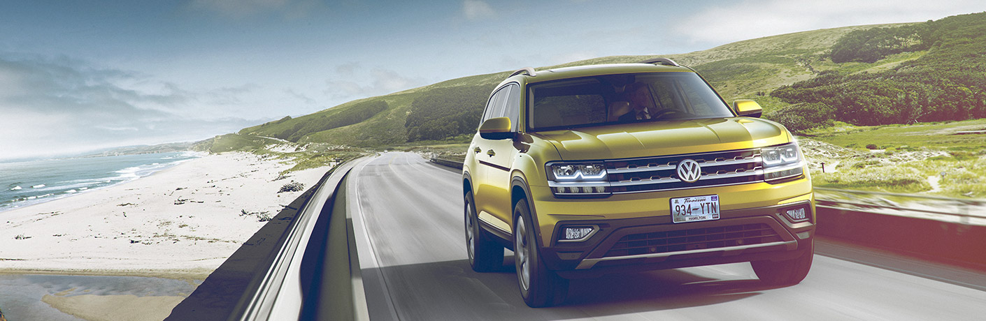 Gold 2018 Volkswagen Atlas driving down the highway