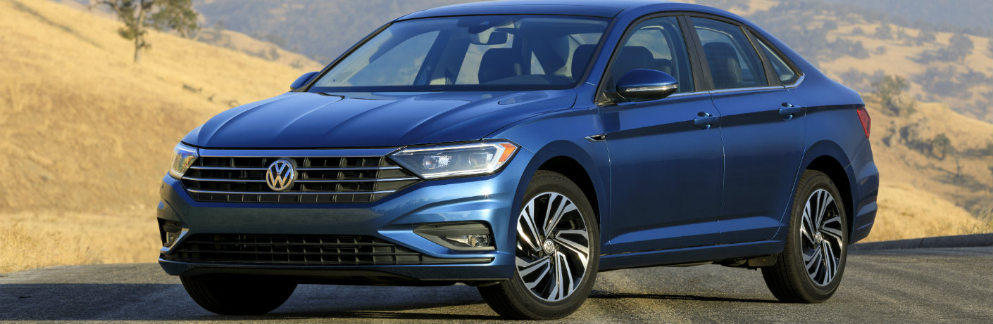 Blue 2018 Volkswagen Jetta parked in the desert