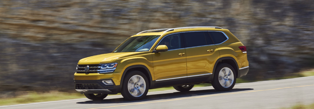 2018 Volkswagen Atlas driving down a sloped road