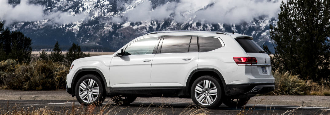 2018 Volkswagen Atlas driving on a road with a mountain in the background
