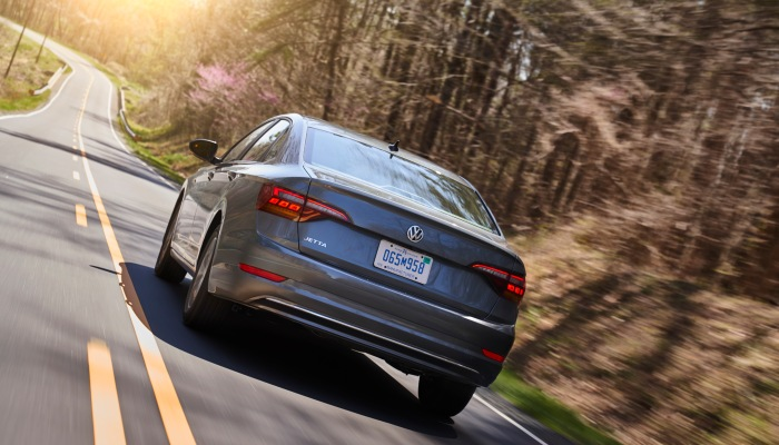 2019 Volkswagen Jetta driving on a forested road