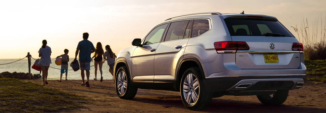 2019 Volkswagen Atlas parked on a beach at sunset