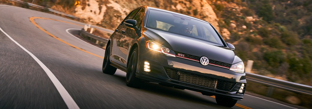 2019 Volkswagen Golf GTI driving down a winding road