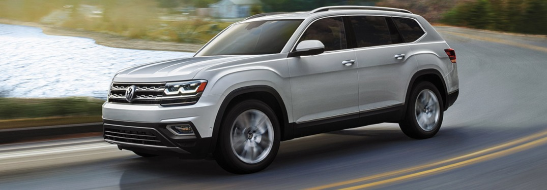 2019 Volkswagen Atlas driving on a road by a lake