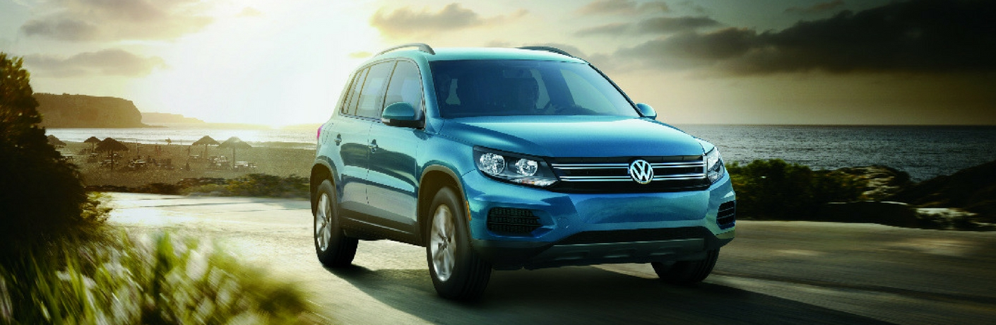 2017 VW Tiguan Limited driving with the sun rising behind it