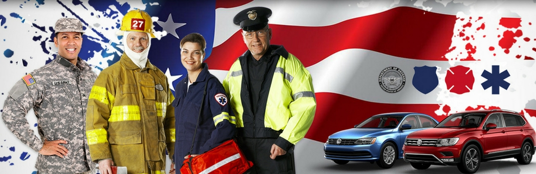 Military and first responder personnel in front of flag with vw vehicles