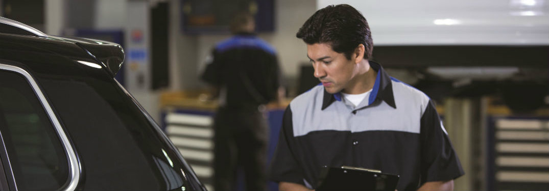 Is it better to service your car at the dealer?